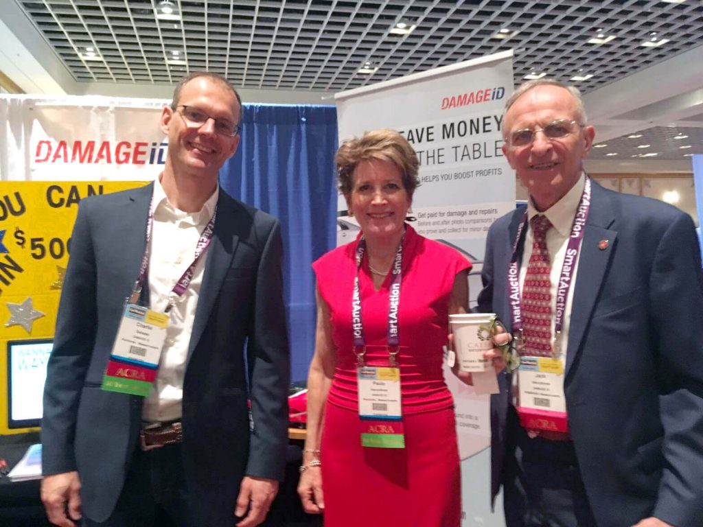 Carlie Dalsass and Paula and Jack Vercollone at the DAMAGEiD booth at the Paris Hotel in Las Vegas.
