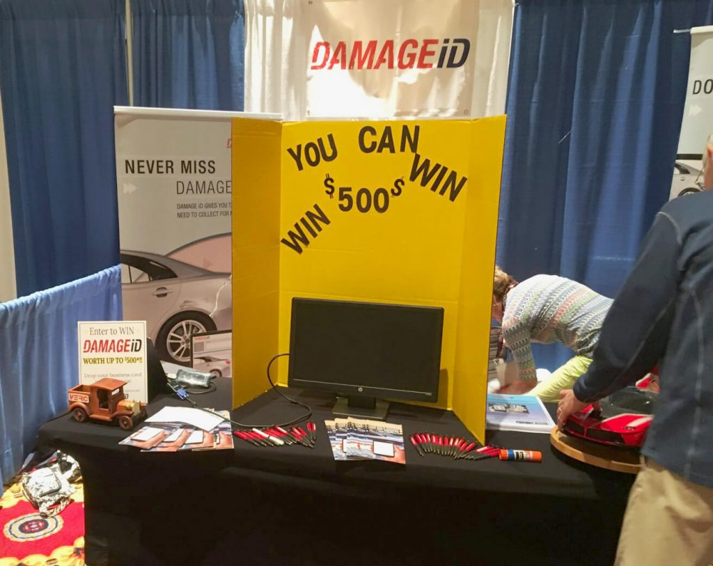 Setting up the DAMAGEiD presenter's booth at the 2019 International Car Rental Show.